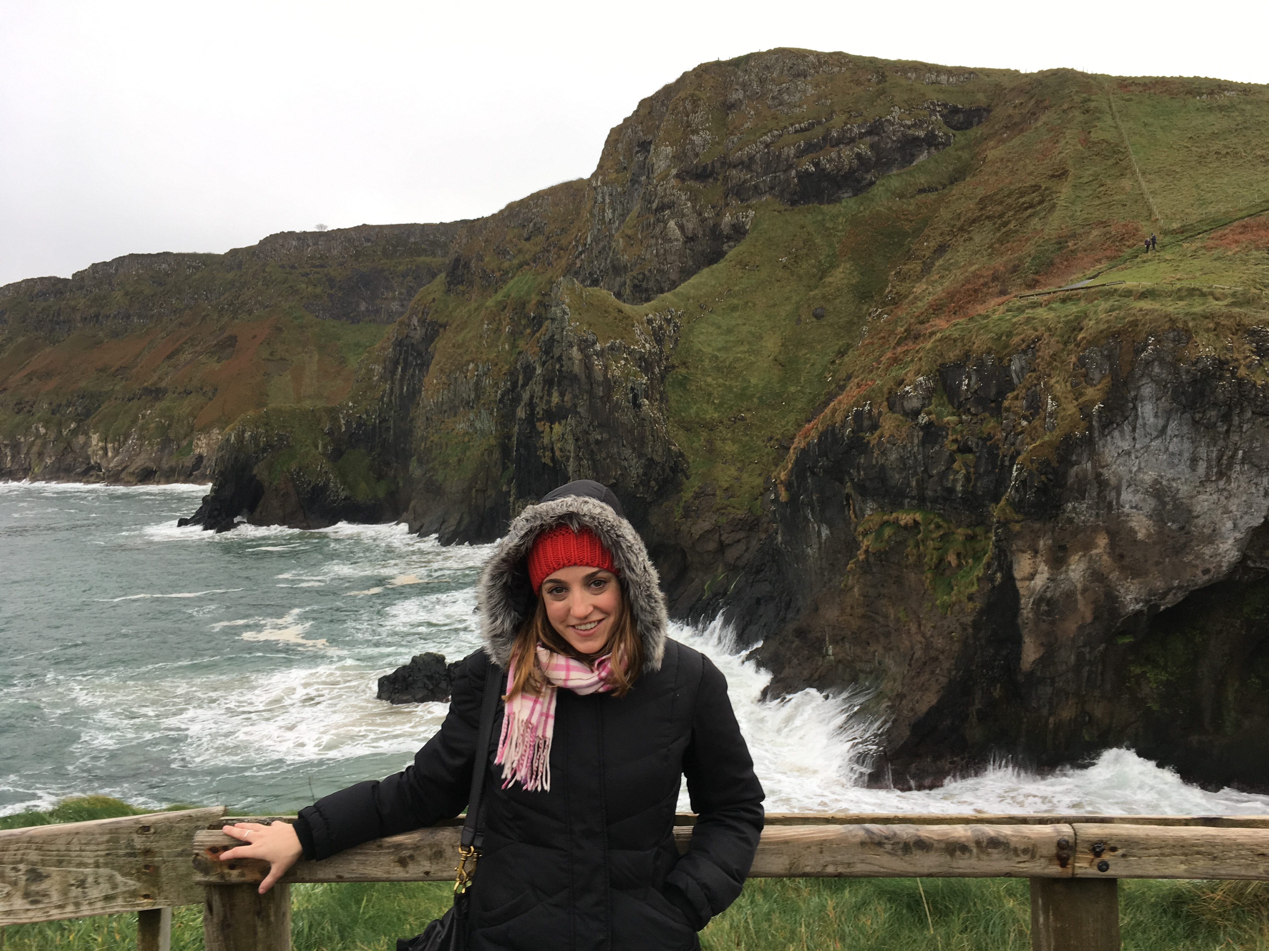 Here's Katie in Northern Ireland. Why is she touching this fence so awkwardly? Unclear.